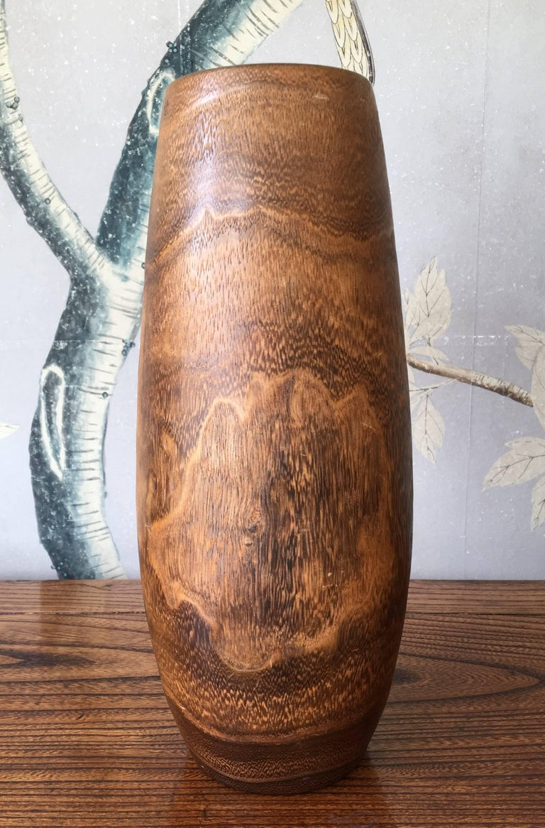 An antique Japanese hand-carved wooden Ikebana vase with design of birds and leaves with a copper liner. Great for flower displays.
