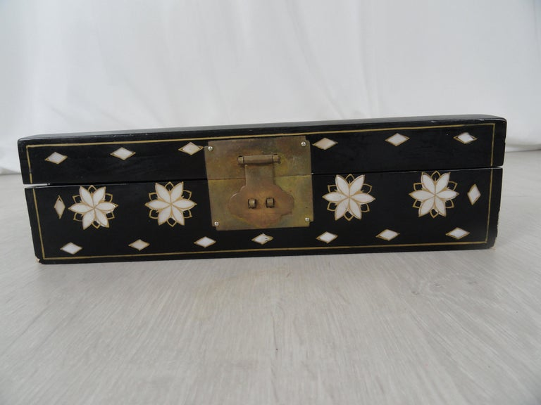 Early 20th century jewelry box with inlaid accent detail. Original brass hardware. Mirror in lid. Red velvet lining.