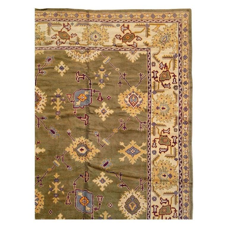 Rustic Early 20th Century Khaki Green Large Oversized Turkish Oushak Handmade Carpet For Sale