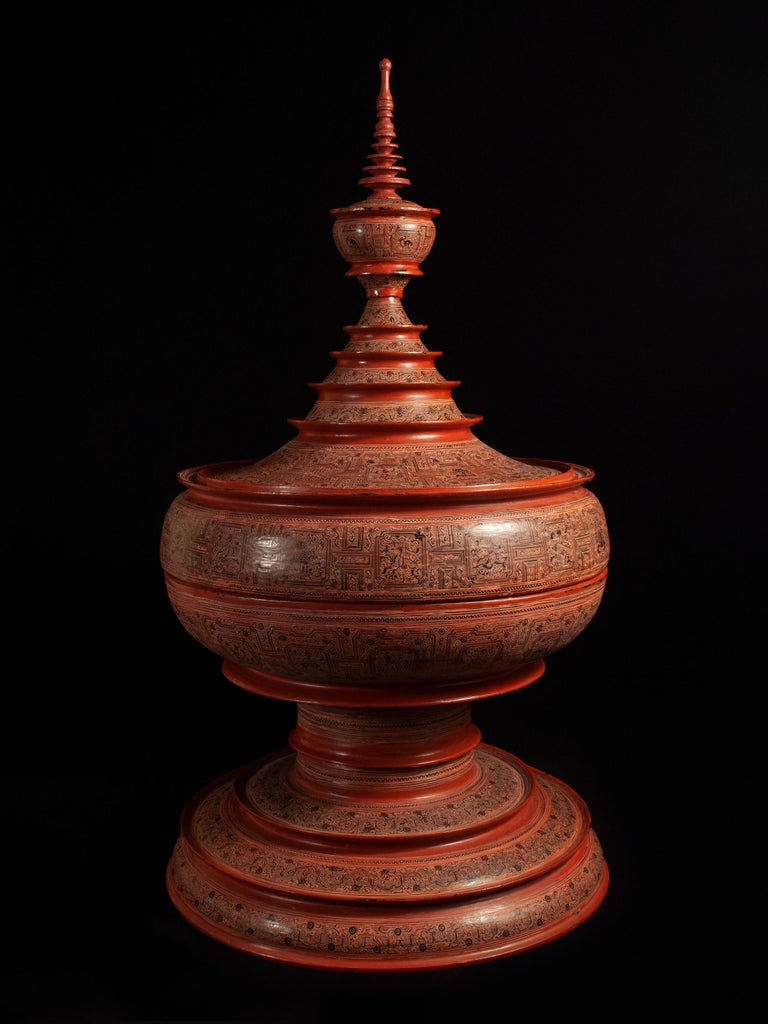 Early20th century lacquer and bamboo offering Vessel, Hsun Ok, Pagan, Burma  An imposing offering vessel composed of six pieces, with an inner tray adorned with the image of an elephant. The stepped panels of the two center bands are known as