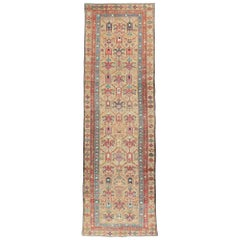 Early 20th Century Light Brown, Purple, Rust, and Blue Persian Tribal Runner