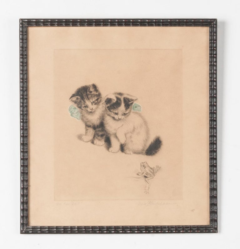 A cute lithograph of two kittens accompanied by a frog. Signed below with pencil by the artist: Meta Plückebaum. On the left the title