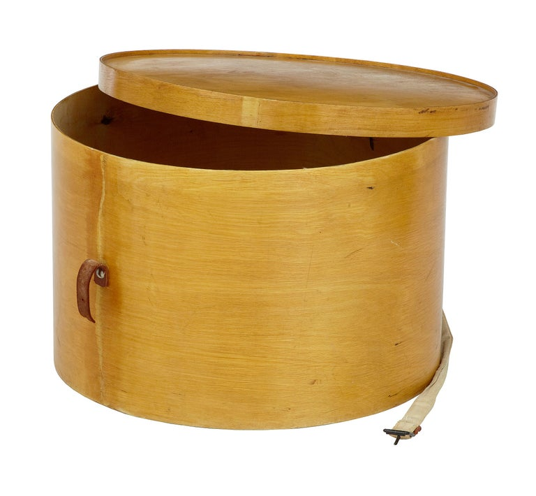 1920s Luterma Reval birch bentwood hat box.  Good quality shaped plywood box by the reknowned makers luterma. Stamped on the inside of lid and on the base. In generally good condition,  Strap has broken and in need of replacement.