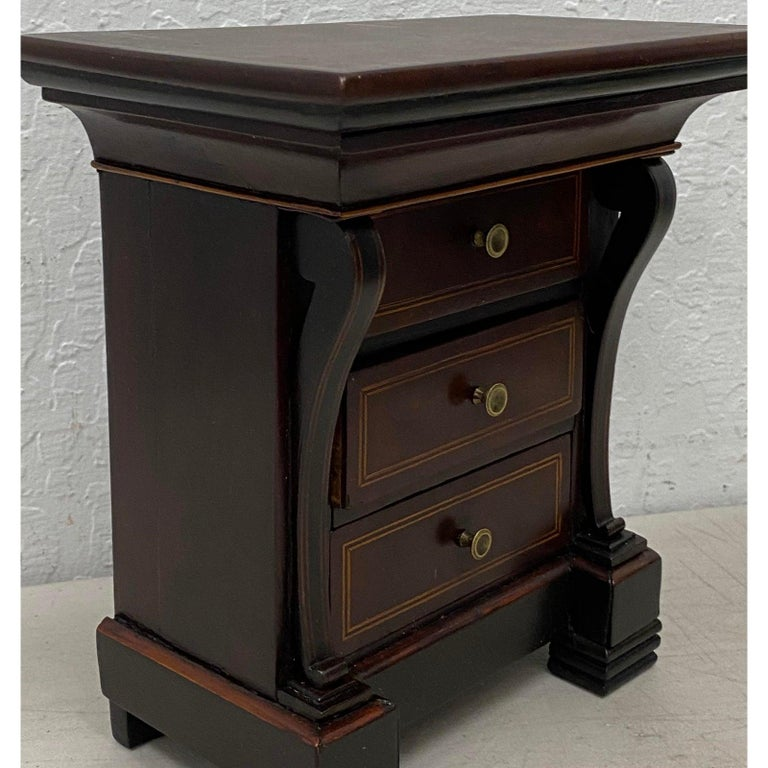 Early 20th century mahogany jewelry box  Lovely box with three pull-out drawers and one lift top section with mirror.  Dimensions 8.75