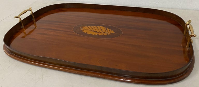 Early 20th century mahogany serving / bar tray with shell inlay  Gorgeous handcrafted serving tray. Made with old growth mahogany with maple inlay.  The serving tray is in excellent condition, but could use some new felt strips on the bottom