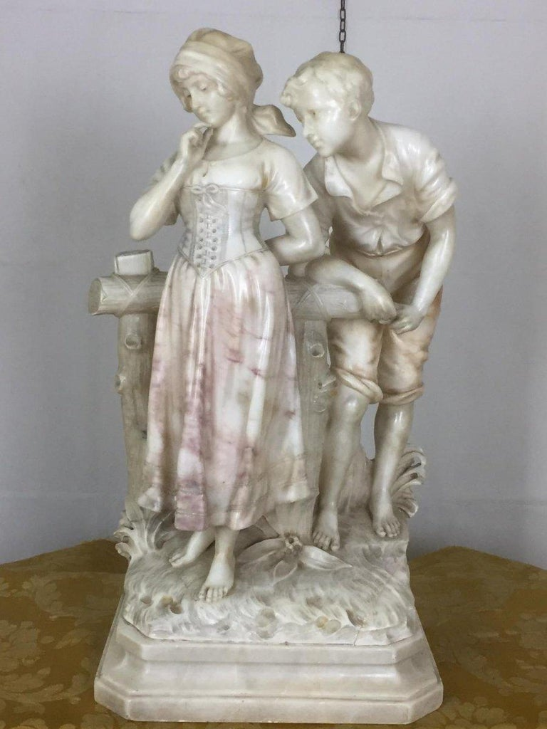 An interesting 20th century white Carrara marble sculpture by the Italian artist Cipriani representing two young lovers. The sculpture is signed on the base.  Dimensions: Height 67 cm Base 34 cm x 25 cm In good condition.