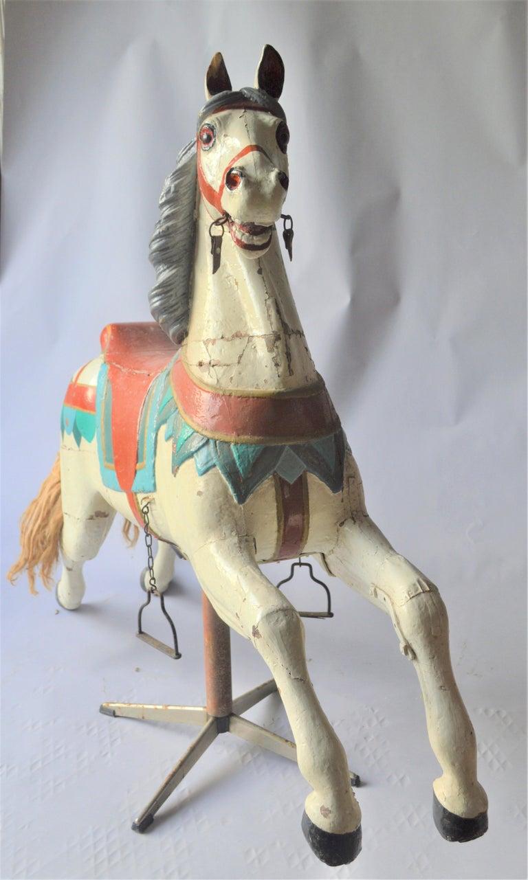 Merry go round wooden horse on modern foot.
