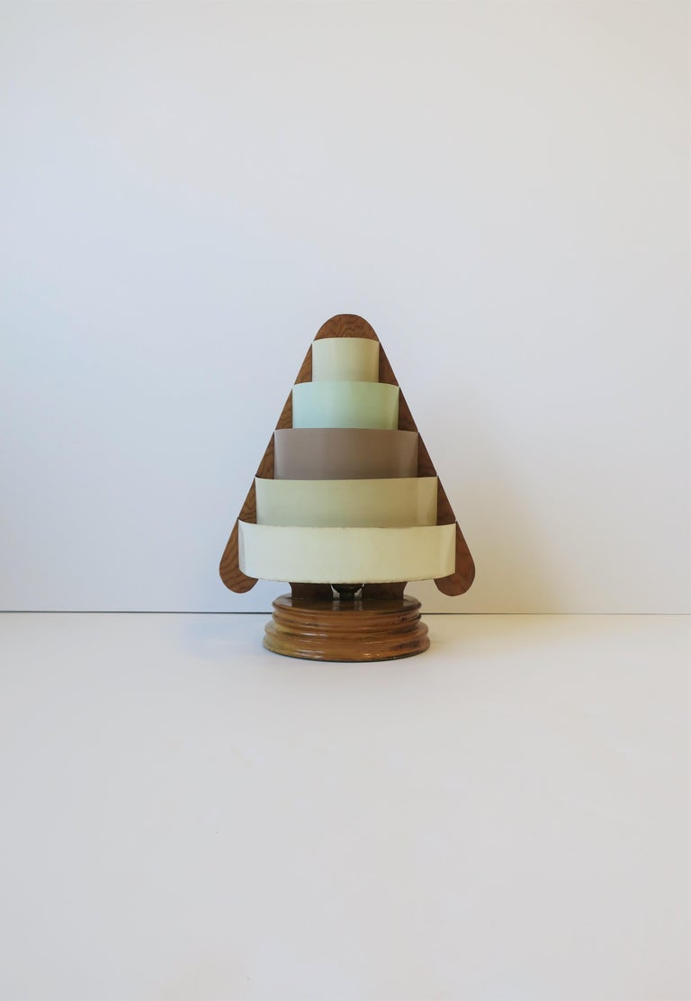A rare early-20th century Art Deco Modern desk or table Lamp, circa 1930s. Lamp is wood with metal ring(s) shade. On/Off pull chain at back strategically positioned to the left for easy on/off as show in images #16 and 17. In working order as show