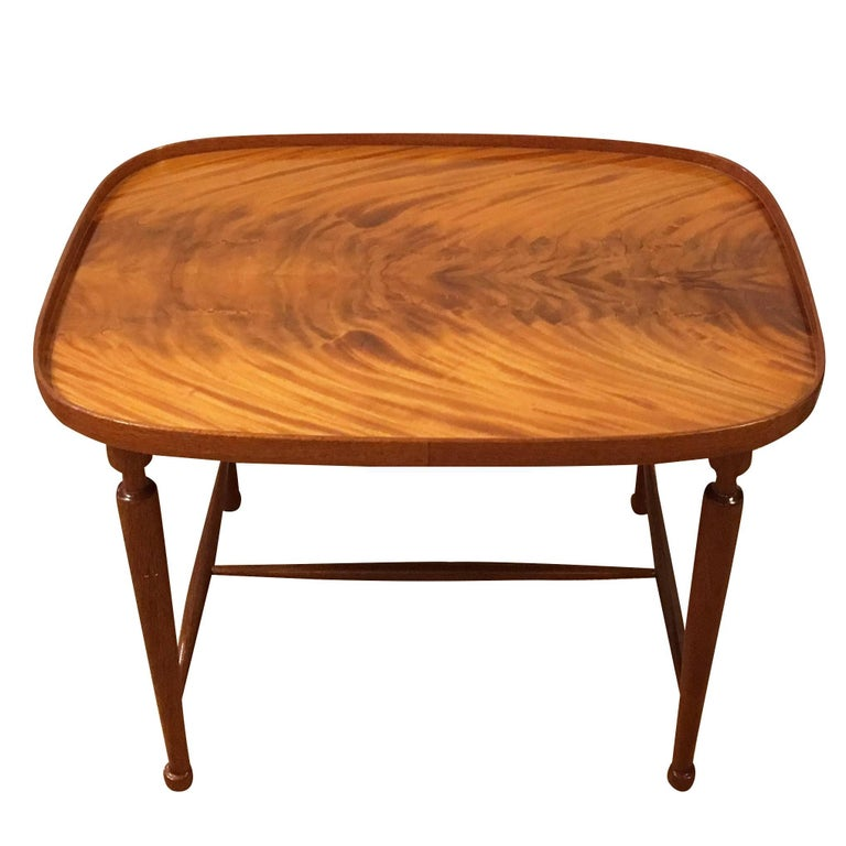 A vintage Swedish Art Deco period coffee table made of hand carved Cuban mahogany wood finish, designed by Josef Frank and produced by Svensk Tenn. Model 974 in good condition. Wear consistent with age and use, circa 1920-1930, Sweden,