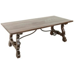 Early 20th Century Oak Spanish Renaissance Style Dining Table, Iron Stretcher