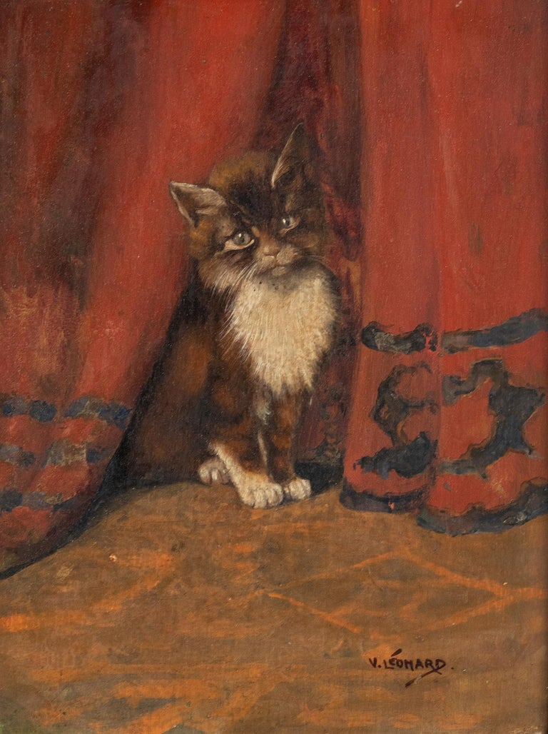 A lovely painting of a young cat between the curtains. The painting is signed lower right. V. Leonard. Information about the painter is unknown. It probably comes from Belgium or France and was made around 1910-1930. It is painted with oil paint on