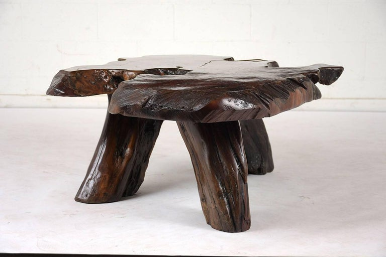 This 1930s Art Nouveau Coffee Table is made from a free form tree root stained in a rich walnut color with a lacquered finish. This Coffee Table is stunning, sturdy, and ready to be used in any home for years to come.