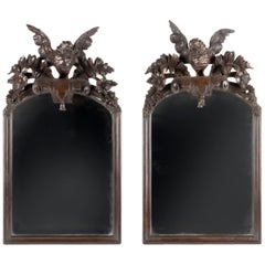Early 20th Century Pair of Hand Carved Oak Black Forest Style Carved Mirrors