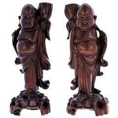 Early 20th Century Pair of Carved Tamarind Wood Buddha Candleholders