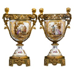 Early 20th Century Pair of Continental Gilt Bronze-Mounted Painted Porcelain Urn