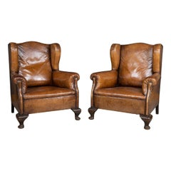 Early 20th Century Pair of Dutch Leather Wing Back Armchairs, circa 1900
