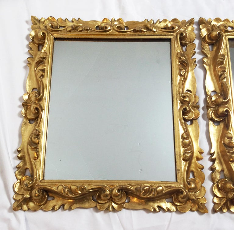 Early 20th century pair of Italian gold gilt carved wood mirrors, nice smaller size that is great for bathroom or hallway. Dimensions: 14