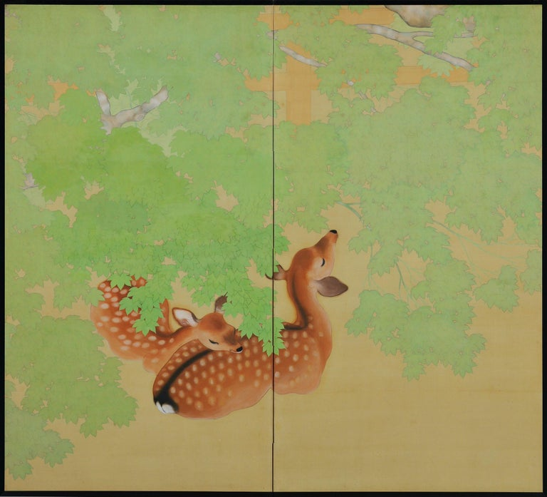 Deer under maples  Late Taisho period, circa 1925-1930  Pair of two-panel screens. Ink and pigment on silk.  Signature: Goho  Seal: Goho  A pair of two-fold Japanese silk screens from the later Taisho period depicting deer under maple