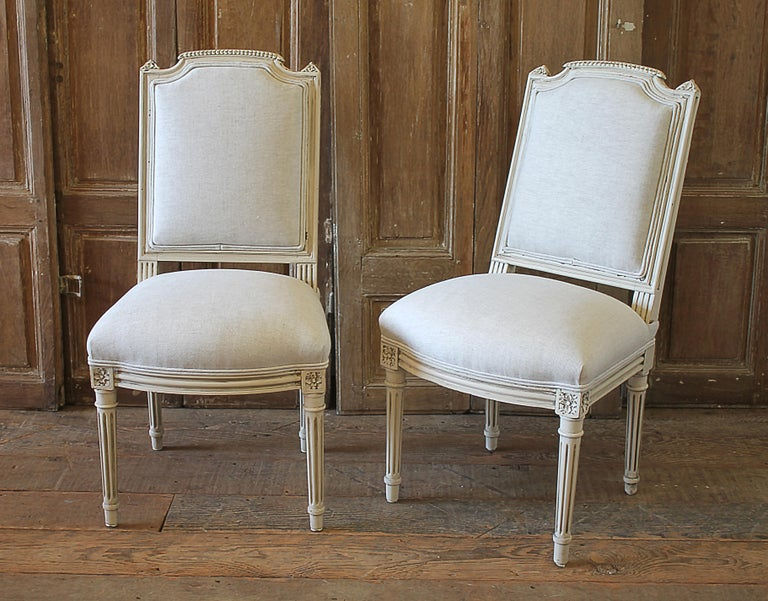 Very petite 20th century pair of painted chairs can be used for kids room. Beautiful pair of painted chairs in our oyster white finish, with subtle distressed edges, and finished with an antique glazed patina. Classic Louis XVI style. Reupholstered