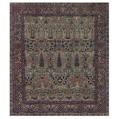 Early 20th Century Persian Kirman Blue, Brown, Green, Pink and Red Wool Rug