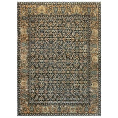 Early 20th Century Persian Kirman Midnight Blue and Camel Handwoven Wool Rug