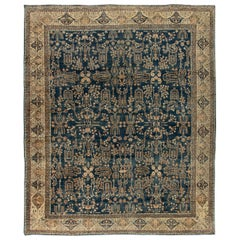 Early 20th Century Persian Kirman Navy Blue and Camel Wool Rug