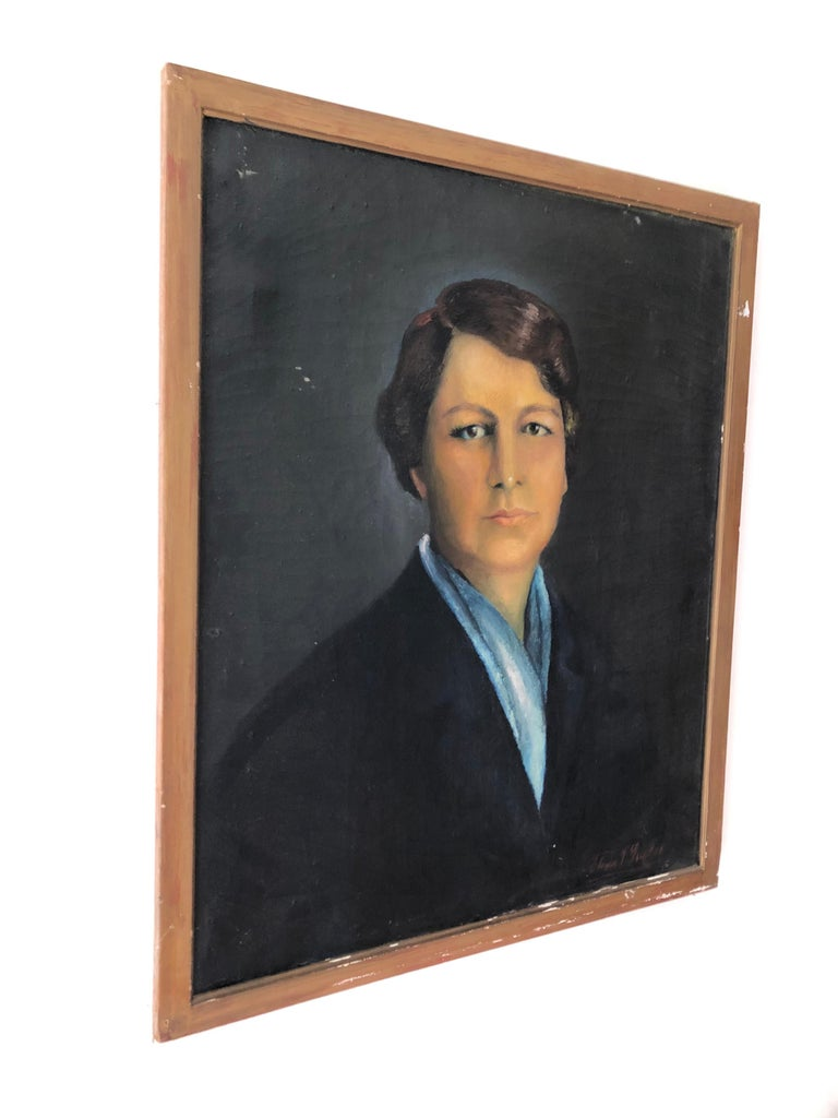 An early 20th century oil on canvas portrait of an Argentinian woman. In original wood frame. Illegibly signed lower right. Measures: Sight 23.25
