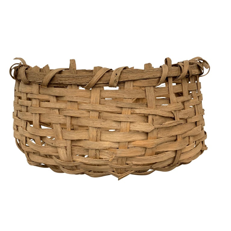 An early 20th century Bulgarian Primitive splint basket, not tightly woven, and not super refined, but a fantastic shape and equally fascinating structure.