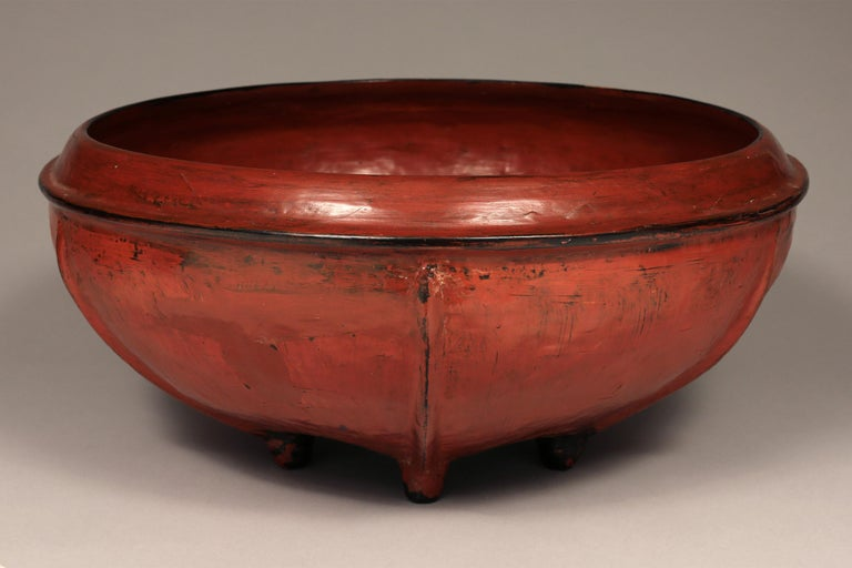 Burmese woven bamboo and red lacquered offering bowl, early 20th century  This lovely offering bowl features six ribs and six feet. Woven bamboo is lacquered in layers - first black, then red achieving the distinctive look of Burmese lacquerware.