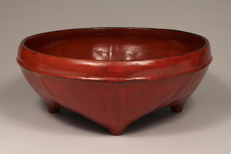 Burmese woven bamboo and red lacquered offering bowl, early 20th century  This lovely offering bowl features eight ribs and four feet. Woven bamboo is lacquered in layers - first black, then red achieving the distinctive look of Burmese