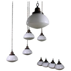 Early 20th Century Run of Nine Copper, Opaline and Frosted Glass Pendants Lights