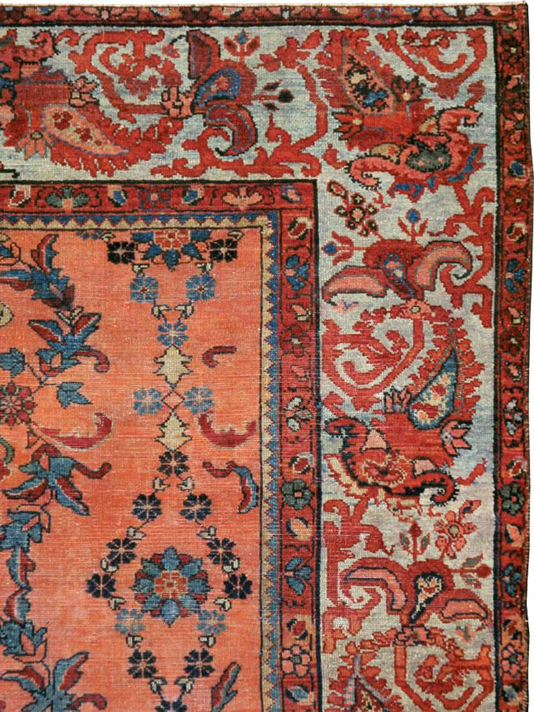 Persian Early 20th Century Scarlet Red and Slate Blue Unique Floral Carpet For Sale