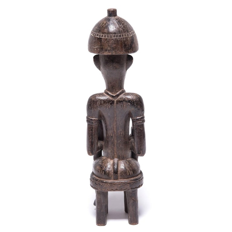 Ivorian Early 20th Century Senufu Seated Female Guardian For Sale