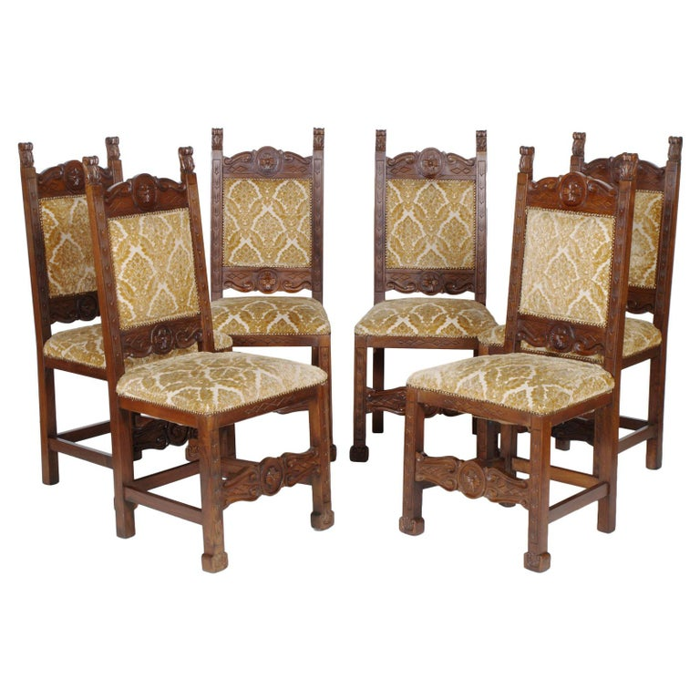Early 20th Century Six Renaissance Chairs, in Solid Walnut Richly Hand Carved For Sale