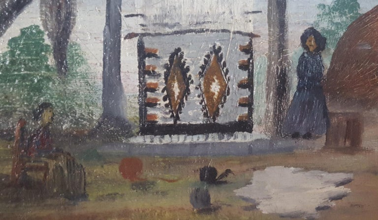 This naive oil painting of two Navajo Women in an outdoor landscape includes a circa 1910 - 1930 style woven rug on a primitive loom, mounted under a large tree. There is a Hogan dwelling nearby and a sheepskin on the ground, along with large balls