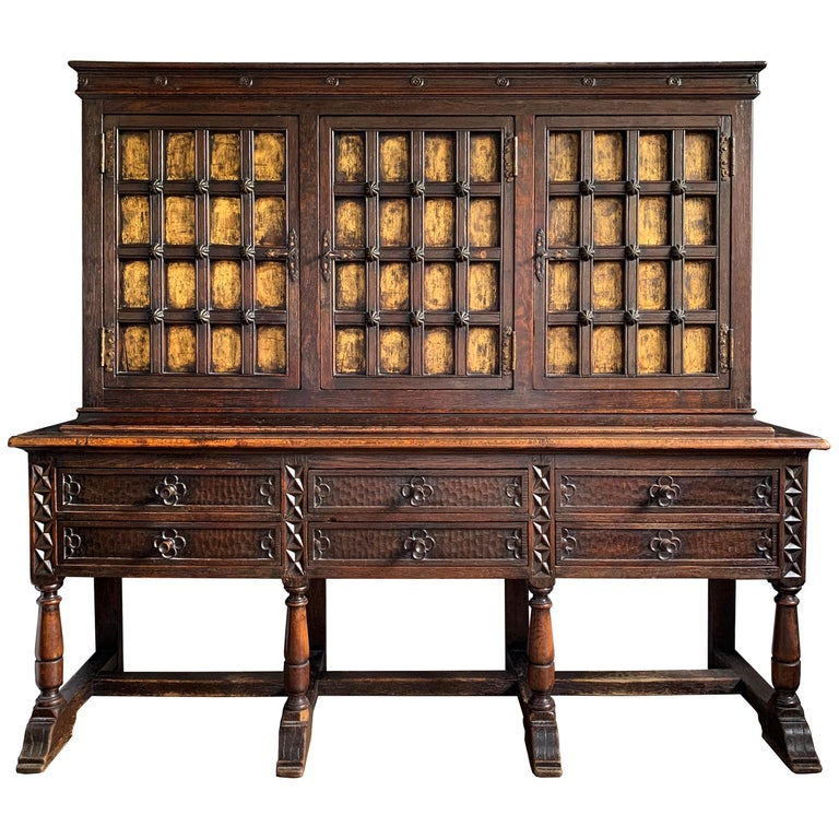 Tudor-revival cabinet with gold-leaf paneled doors, early 20th century, offered by RIGHT | PROPER