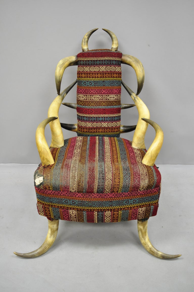 Early 20th century steer Horn parlor chair. Item features steer Horn frame, burgundy and blue upholstery, desirable size and form, circa early 20th century. Measurements: 41