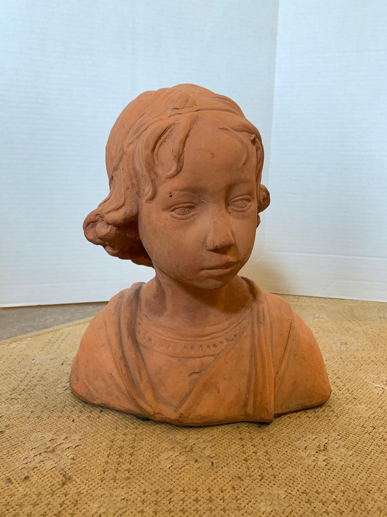 Early 20th century terracotta bust of child.
