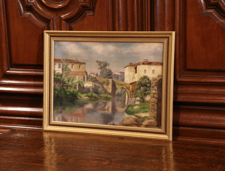 Set in a giltwood frame, the oil on canvas painting depicts a typical Provençal village with