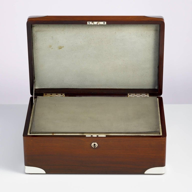An early 20th century walnut cigar Humidor, circa 1900 with sterling silver corners and nameplate. This piece has a campaign feel the corners are perfectly moulded. The walls of the box have a inner insulation felt. There is a separate zinc alloy