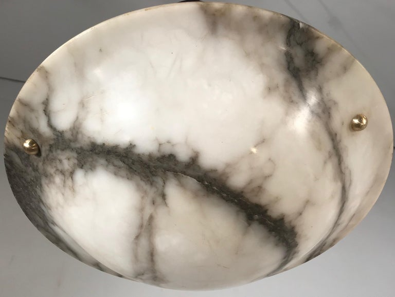 Beautiful design and condition mineral stone pendant.  If you are looking for an excellent condition and practical size Art Deco light fixture then this fine specimen with its beautifully flowing black veins in the shade could be perfect for you.