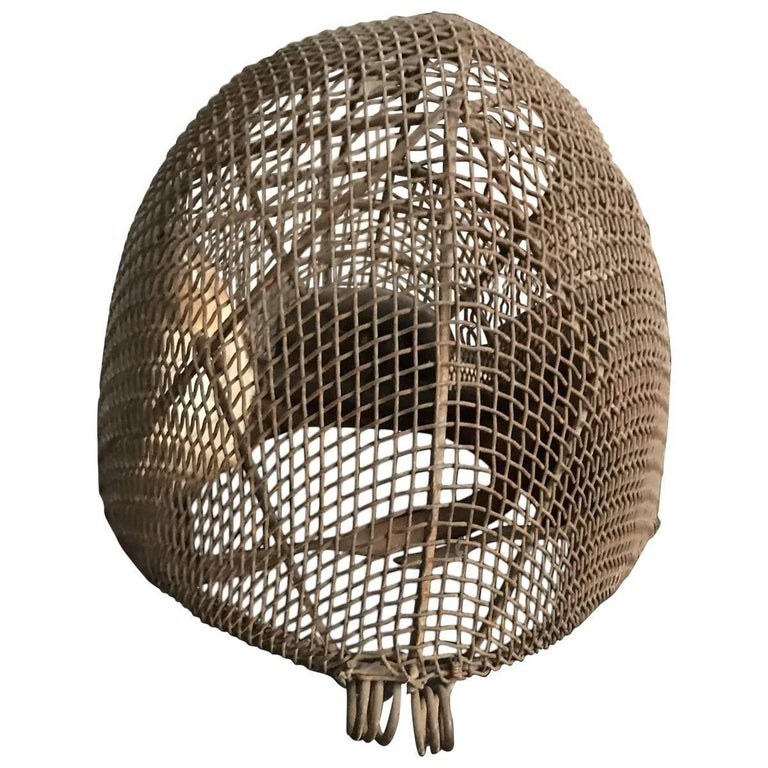 A collectible piece from bygone days, featuring the finest craftsmanship, materials, and design elements of its given era. Original and one-of-a-kind, this antique fencing mask is composed of steel wire with leather chin straps. Handcrafted in the