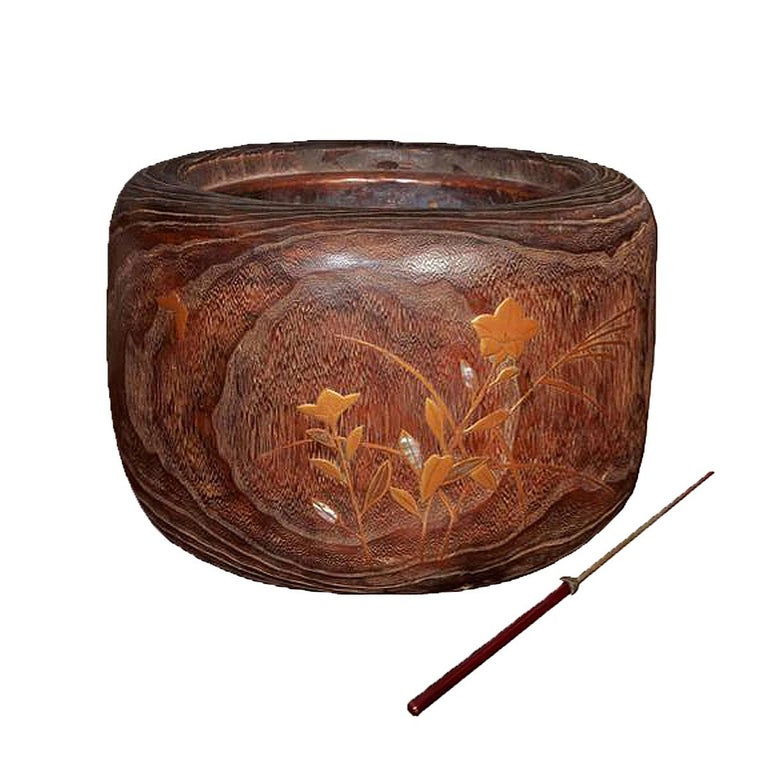 A round wood Japanese braziers / hibachis with an inlaid nature scene in copper and mother of pearl, circa 1890. Copper inserts. Perfect as eye-catching vase or planter.