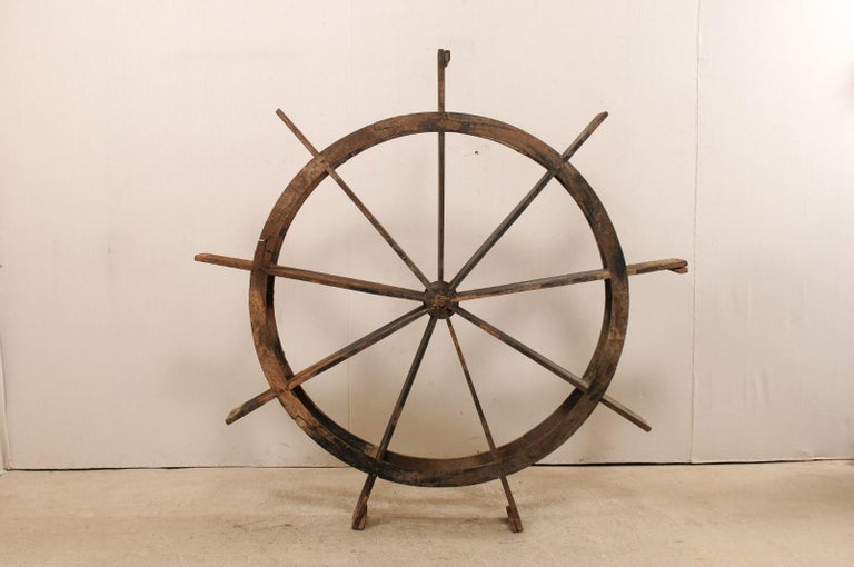 A large antique water wheel from Kerala, India. This Kerala water wheel which stands approximately 6.75 ft tall, also known as a