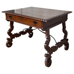Early 20th Spanish Desk with Lyre Legs and Carved Edges on Top
