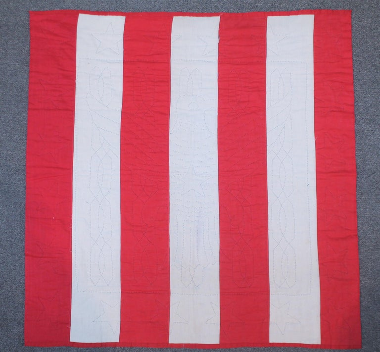 This great patriotic quilt is made from 19th century flag fabric. We believe this to be made in the earlier part of the 20th century. This is a great quilt and in great form. Very rare and amazing condition.