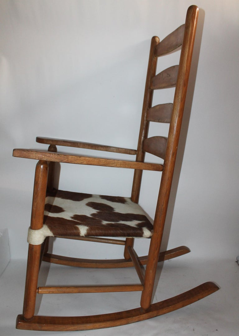 Country Early 20th Century South West Rocking Chair in Cowhide Seat For Sale