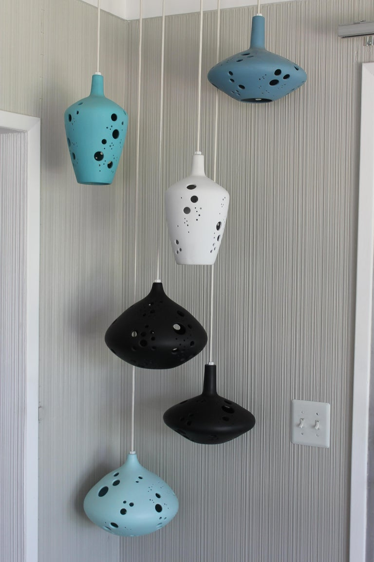 Six very rare ceramic pendant lights from the early 1960s. Three shapes, two of each, in shades of turquoise, black and white. Dimensions vary from 11