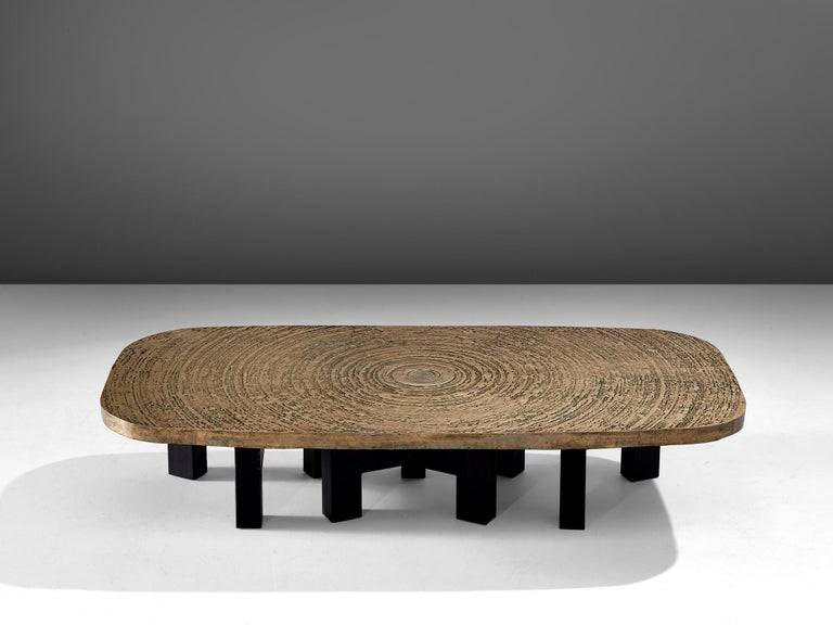 Ado Chale, 'Goutte d'Eau' coffee table, bronze and steel, Belgium, 1970s   Extraordinary coffee table by the Belgian designer Ado Chale. The piece shows a high level of details, notably the cast bronze table top. It shows a serene drawing of a water