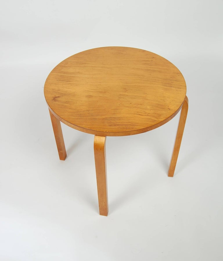 Designed in the 1930s and produced into the 1940s is this series 70 Alvar Aalto side table. Constructed of laminated birch with bent wood legs from Aalto's early design career. Great patina to the surfaces and in unusually good condition for a piece